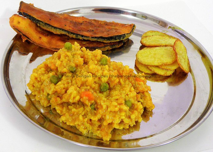 Bhoger khichuri or rice and lentil risotto rice roti and noodles a traditional authentic east indian or bengali recipe bhoger khichuri or khichdit easy forumfinder Choice Image